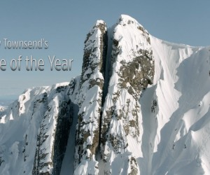 洒落にならないぐらい高所から滑り降りるスキーヤー