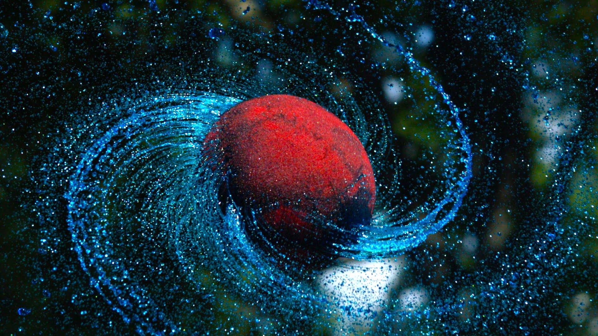 液体につけたボールをスーパースローで撮影すると惑星っぽくなる